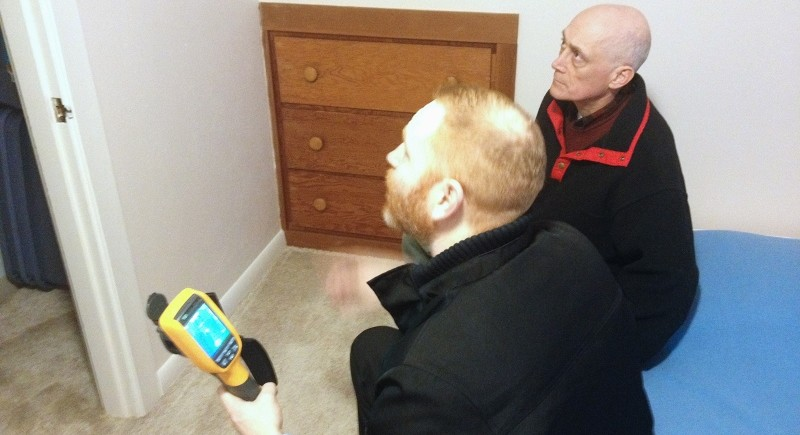 Homeowner Roger Horn and Thurston Energy Manager Mark Rentfrow use thermal imaging to observe an attic hatch through a closet, and discuss how proper insulation and air sealing keeps warm air inside a room